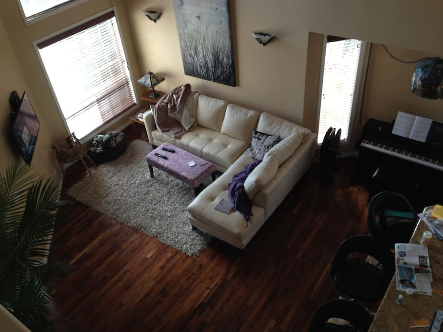 Open living room with TV / piano.