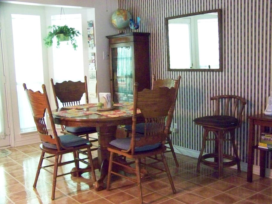 The dining area and the table pulls out to seat more people. Has access to the back screened porch.