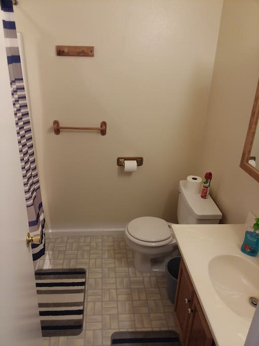 bathroom upstairs with tub, shower, shampoo, conditioner, towels provided. half bathroom downstairs