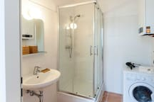 Bathroom with shower and washer/dryer + hair dryer