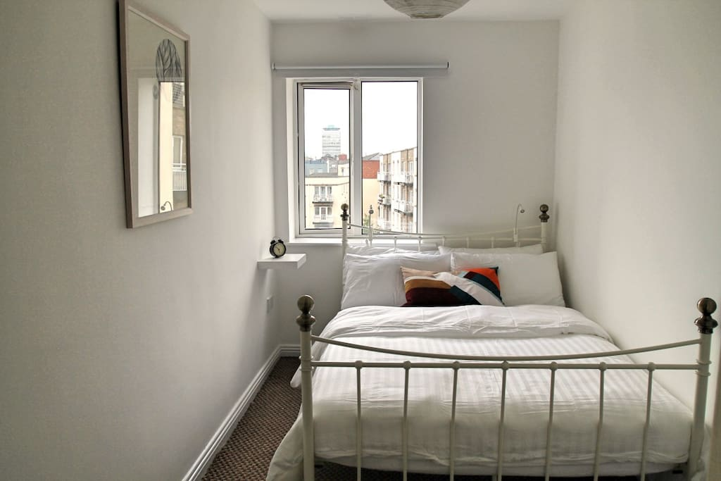 Our bright, spacious bedroom complete with a real double bed