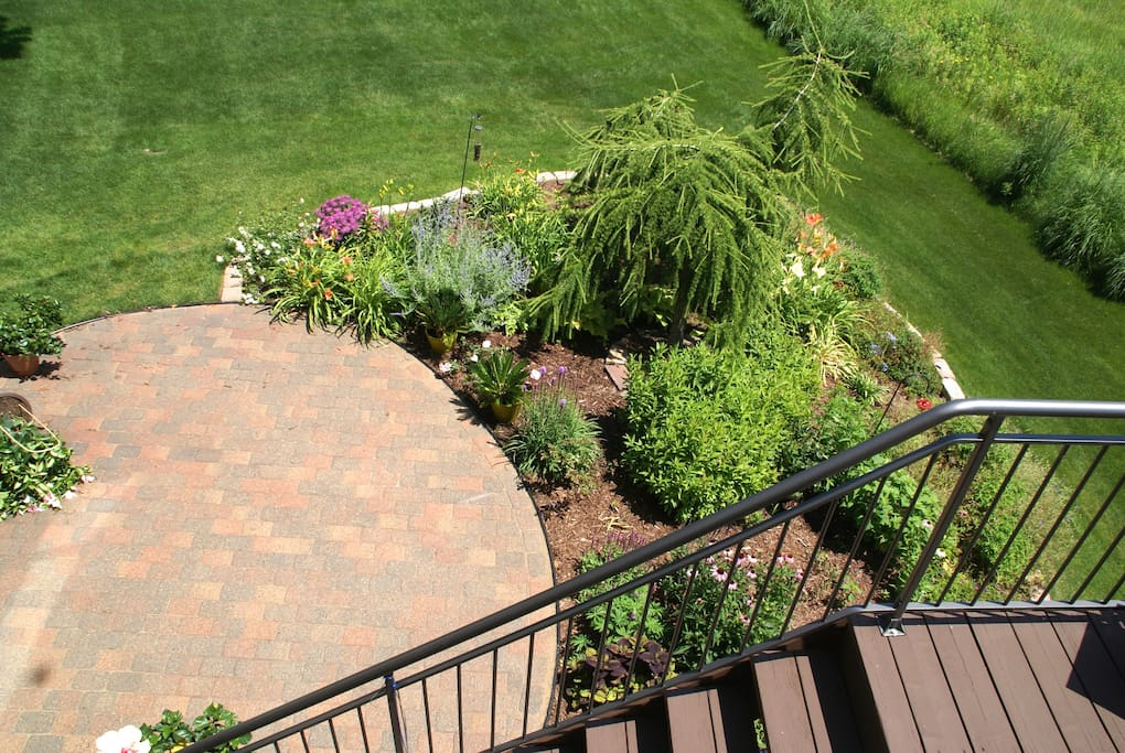 Looking down at the patio from the deck above.