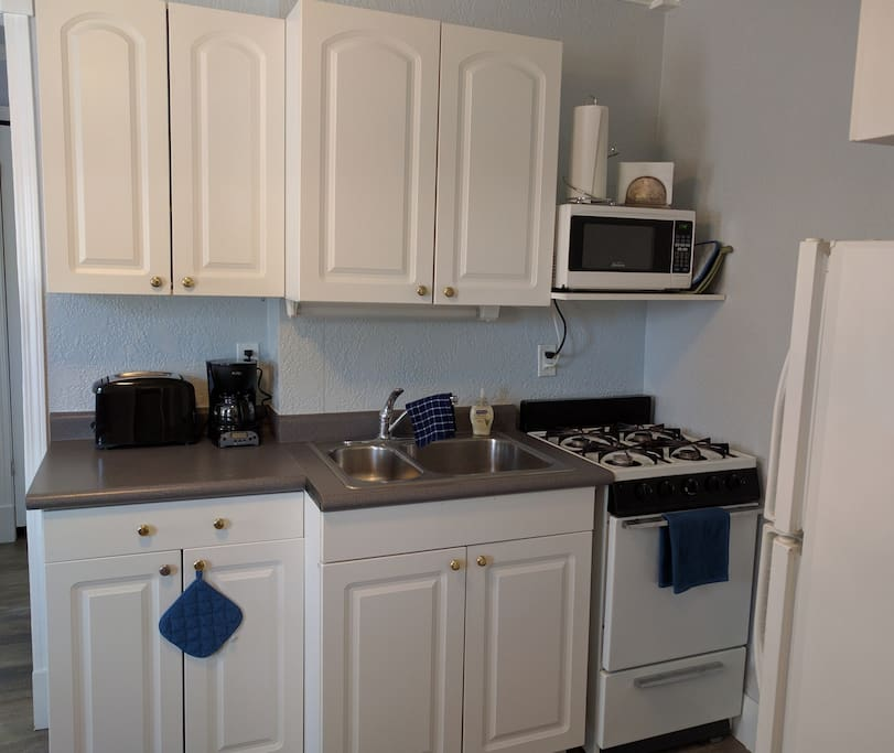 Full kitchen with appliances and utensils