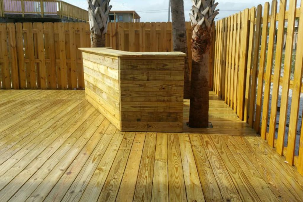 Bar and deck surrounding private salt water pool
