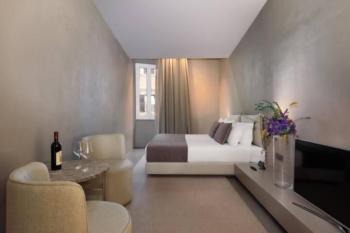 Elegante camera nel cuore di Roma