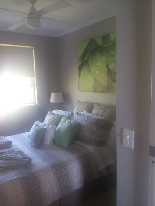 Double bed with a wardrobe and bedside tables for you to store you belongings