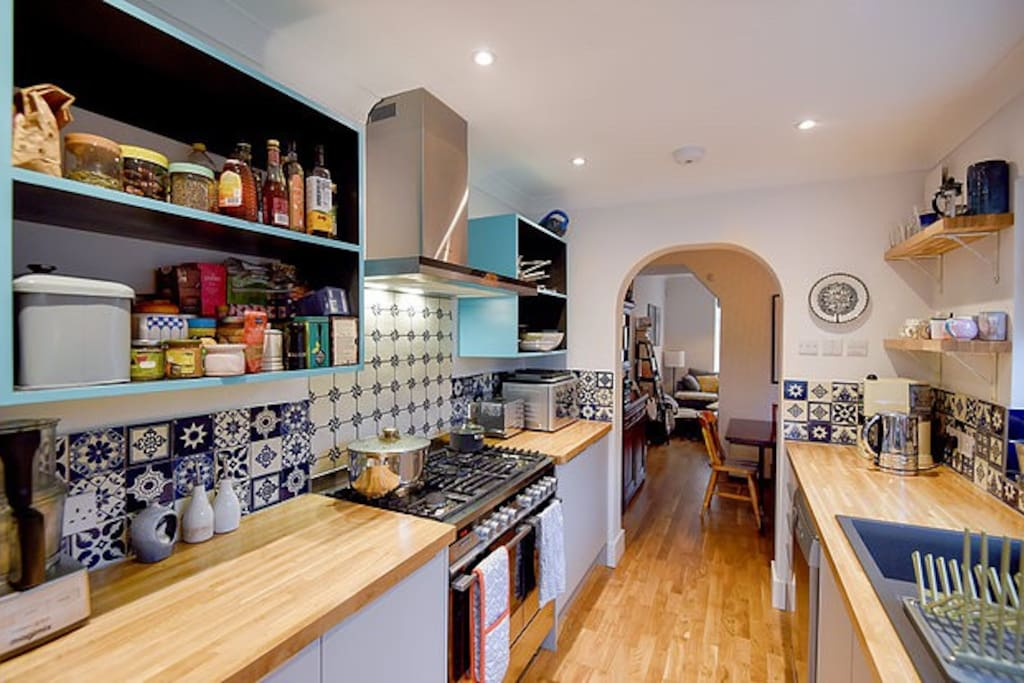 Bespoke kitchen with handmade Mexican tiles and a huge double oven with lots of work space for cooking.
