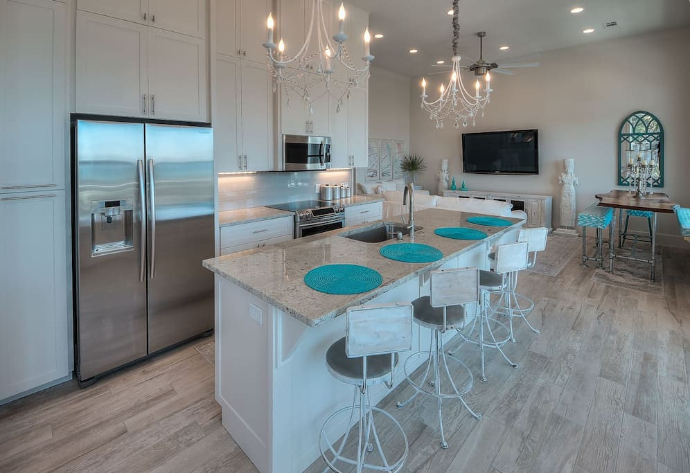 Open kitchen area with bar stool seating