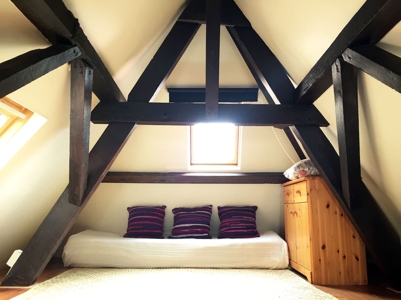 bright and inviting sitting space in the attic room