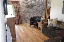 The cosy living room is totally private and has a door to your own garden.