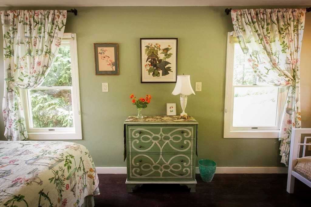 Windows open the room to the beauty of the garden setting.
