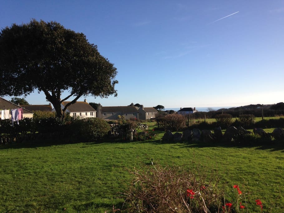 View over rear lawn to the sea at Cadgwith