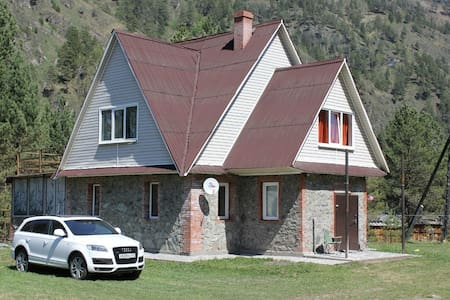 The house in the mountains near the lake Katun