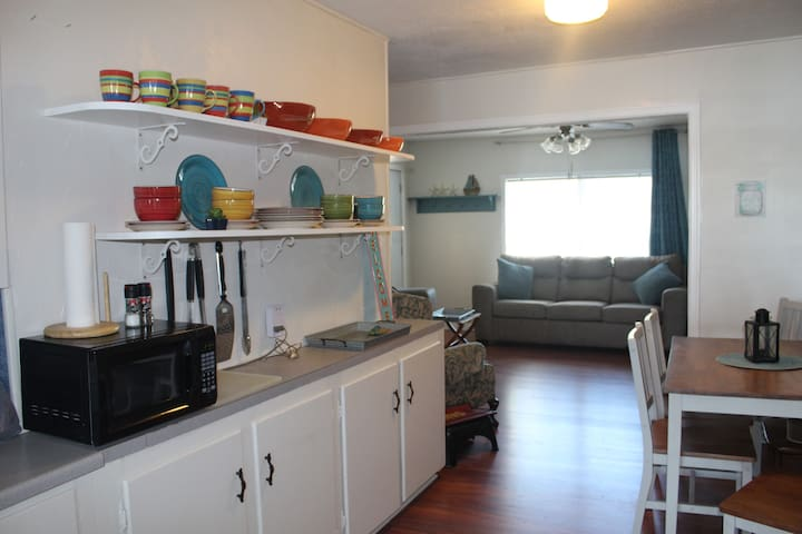 Kitchen is stocked with dishes and cookware.