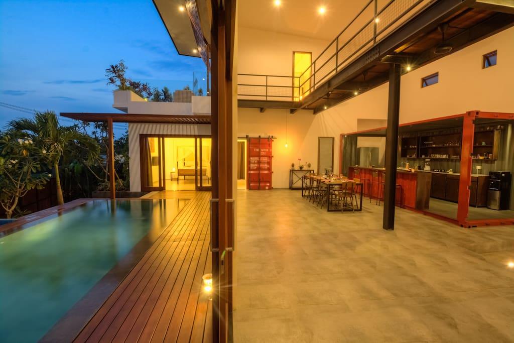 Full length glass doors sliding open to the pool deck