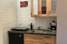 Cozy kitchen with fridge and electric stove