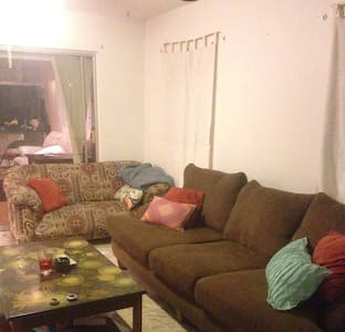 2 comfy couches in a spacious home