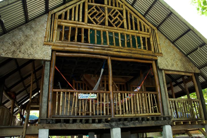 2-storey bamboo hut near the beach.