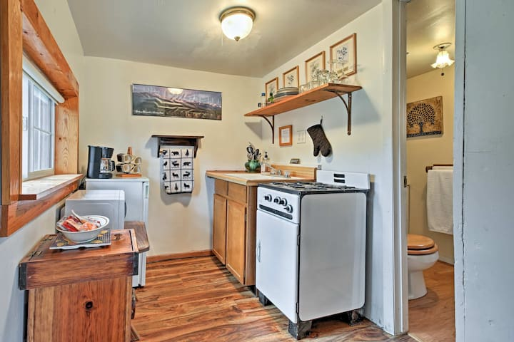 The well-equipped kitchenette includes a stove and oven.