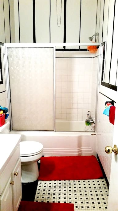 Bright bathroom with spacious shower stall