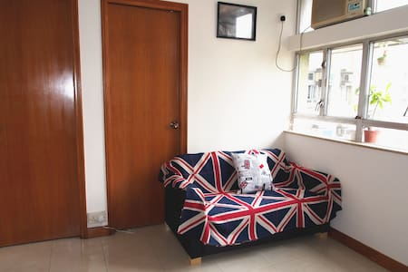 -Home Stay with a sofa bed at living room, it is not a guesthouse. Me and my mum will also be living at this apartment  - Sofa bed (118x 205cm) is at the corner of the living room  and curtain is used to sever your sleeping place   -Kitchen and Bathroom are shared   *special request can be further discussed by sending me message