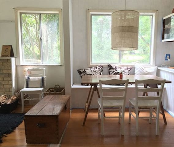 Dining area with bench seat & view into the garden