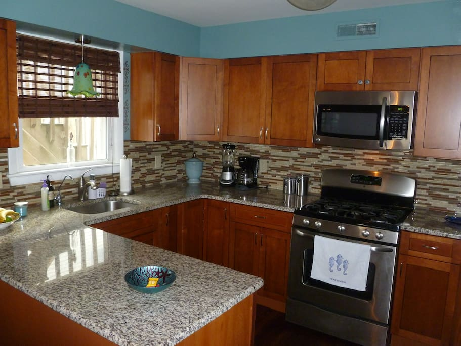 Kitchen, microwave, gas oven and stove, garbage disposal