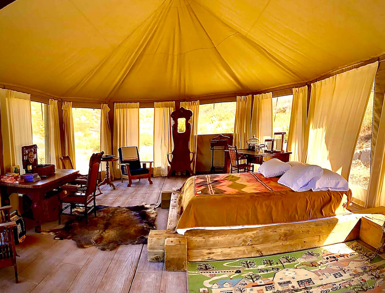 The inside of the Fish Camp Tent.  It was sourced from  South Africa where they are used for luxury safaris. Nearby kitchen and bathrooms with hot and cold water and showers make the Tent equipped for comfort.  The Tent has lake and mountain views.