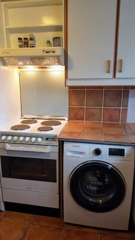 Kitchen, stove and washing machine.