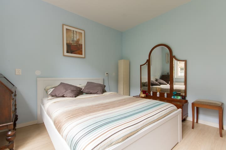 The peaceful and classic master bedroom, with a comfortable bed so you will have a  good night rest at the quiet backside