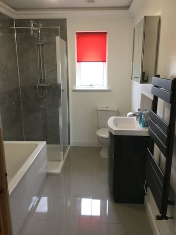 Newly fitted bathroom featuring under floor heating and large walk in shower