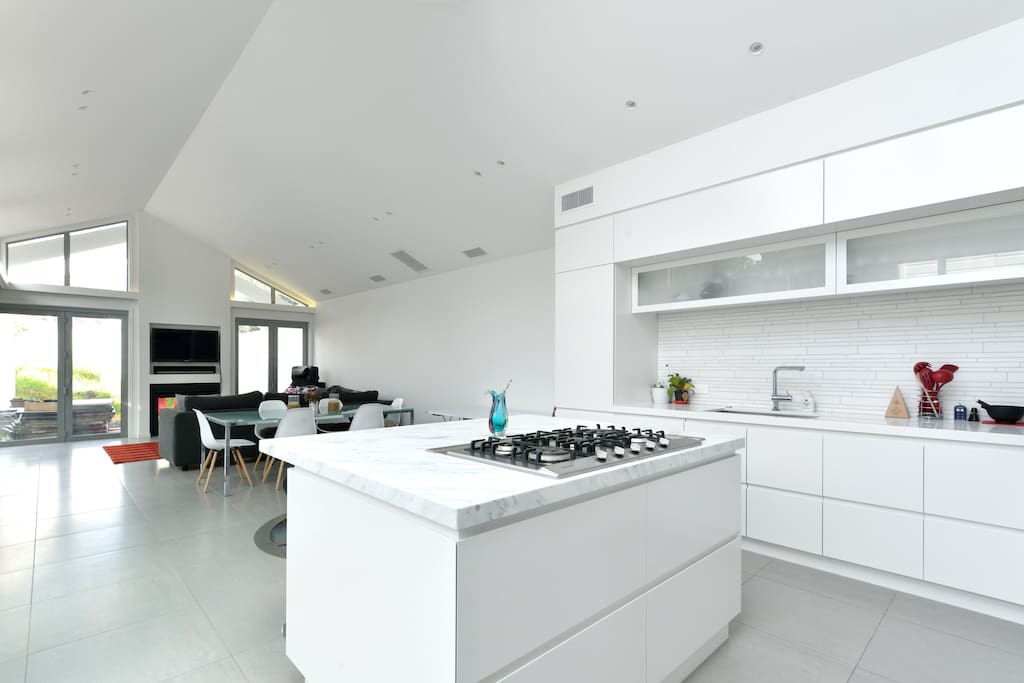 Modern well lit kitchen/dining