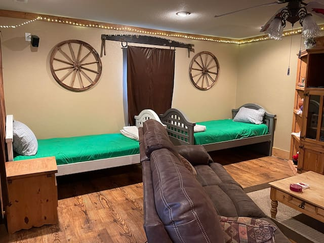 We provide two beds in the main living area that are comfy, set up and ready to go! No messing with a pullout bed! You can also push these together and have an additional king bed to sleep in.