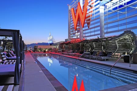 Luxury condo in the famous W Residences in Hollywood, pool side gorgeous modern space with high ceilings, stainless steel appliances in the most luxurious building in LA. Steps away from the best restaurants, highlife, and tourist attractions