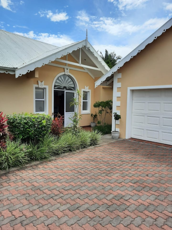 The Yellow Beach House in Caribbean Estates
