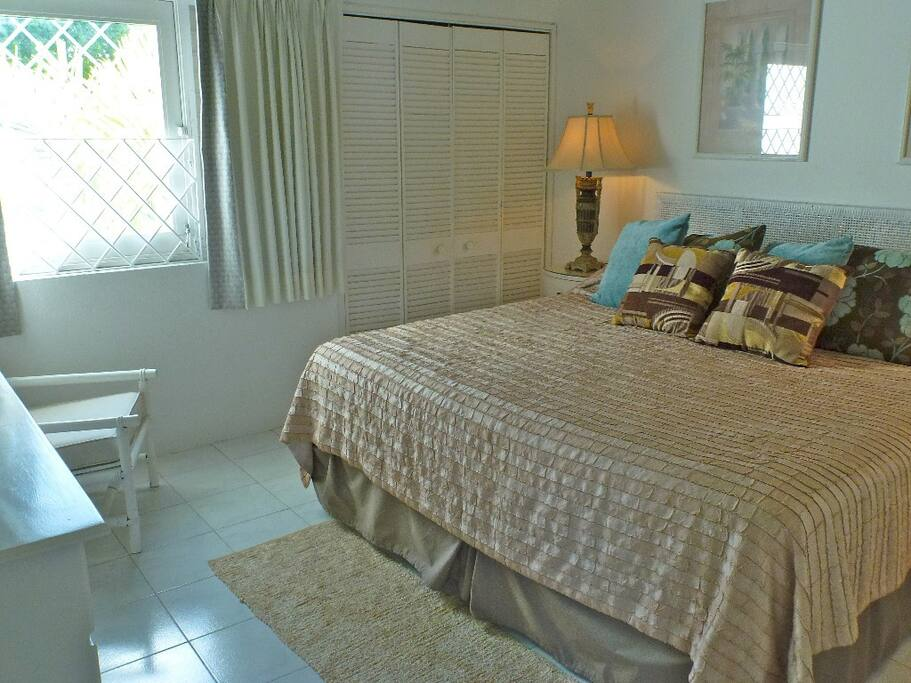 Air-conditioned bedroom with huge bed