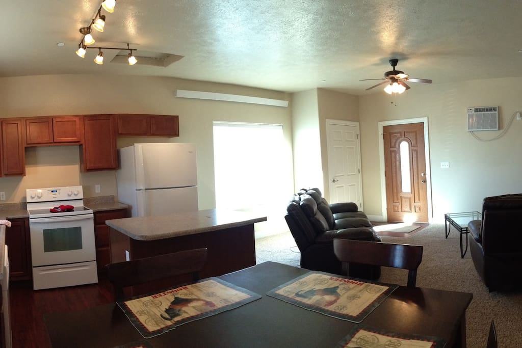 Panorama view of the living, dining and kitchen from the patio door.