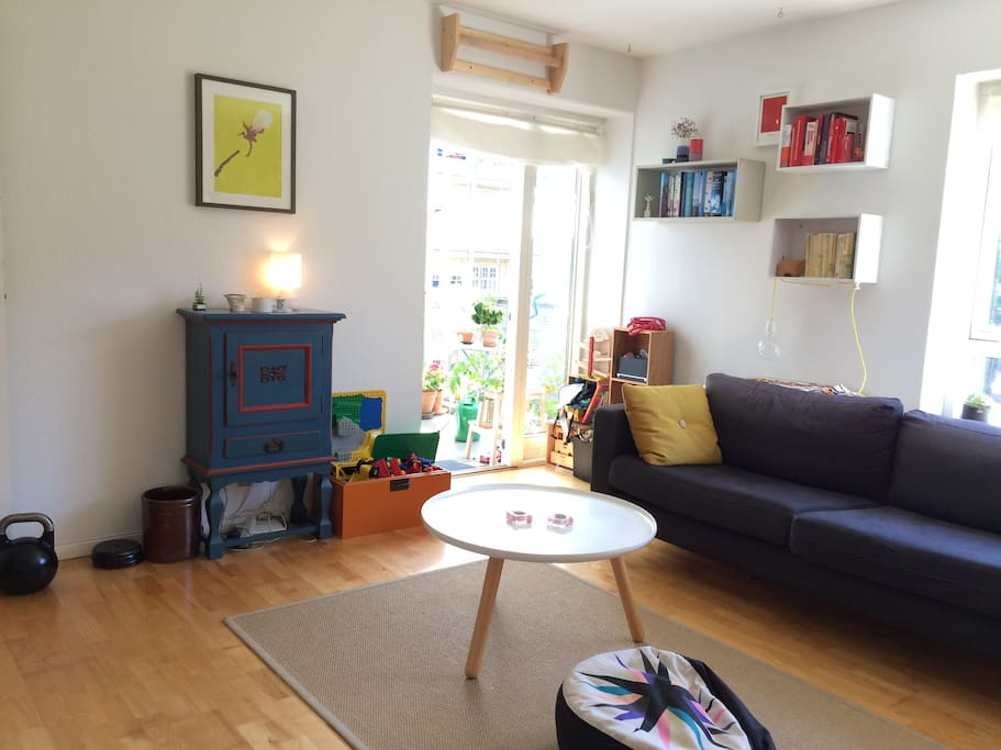 living area with a combination of danish design, toys and room for relaxing.