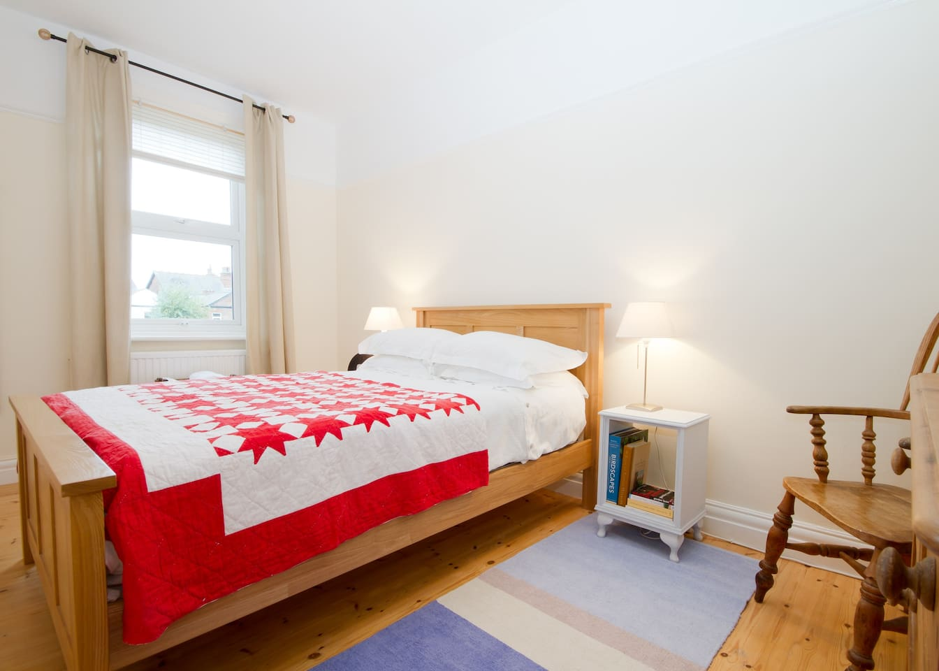 Double room, overlooking the back garden with wardrobe, chest of drawers and desk.