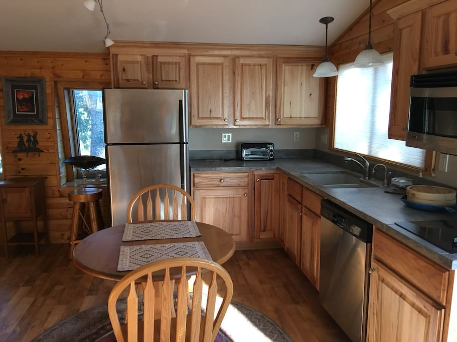The kitchen has a microwave, coffee pot, dish washer, toaster oven and two burners.