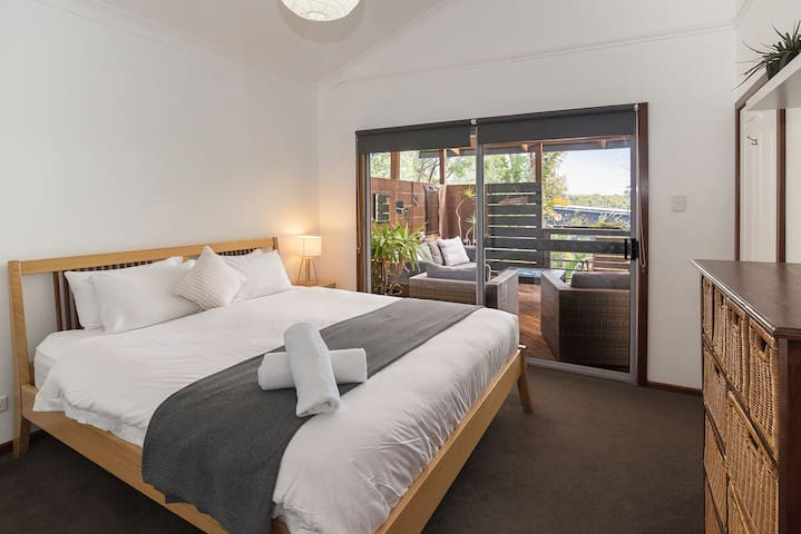 Master bedroom has a king size bed, ensuite and walk-in robe.