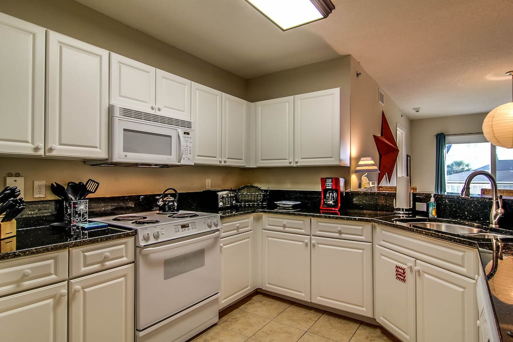 Fully equipped kitchen has granite countertop
