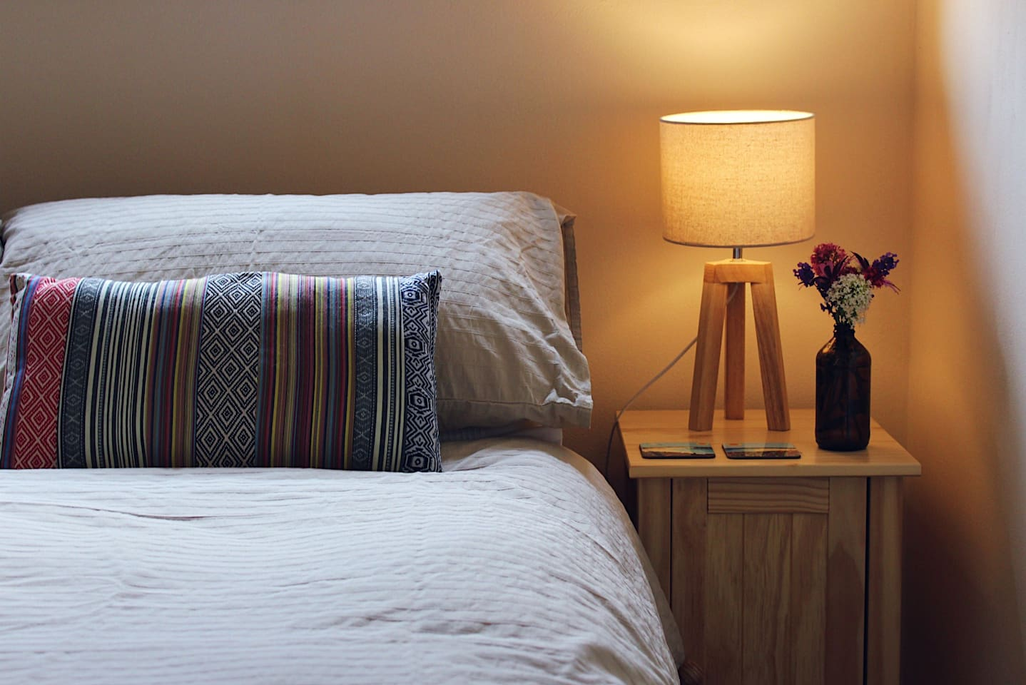 Comfortable double bed with fresh flowers.