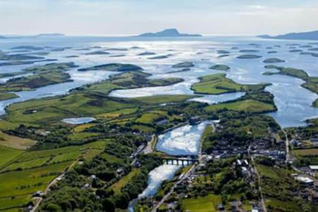 Aerial shot looking out over Newport and Clew bay to Clare Island