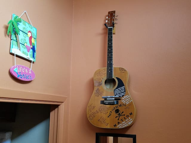 No guest book.  Instead we ask all our guest to sign or write your favorite poem or anything on our guitar. Don't forget! we love to see your messages.