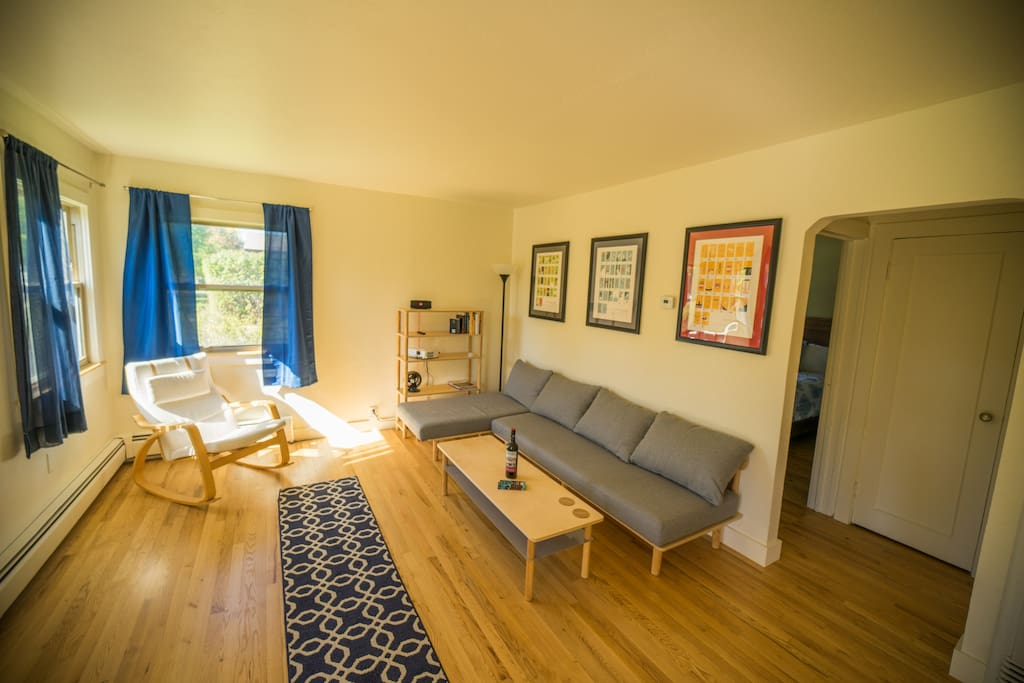 Original oak floors and west/south facing windows lend the living room beautiful natural light throughout the day-- lounge in the living room while you plan your next Bozeman adventure!