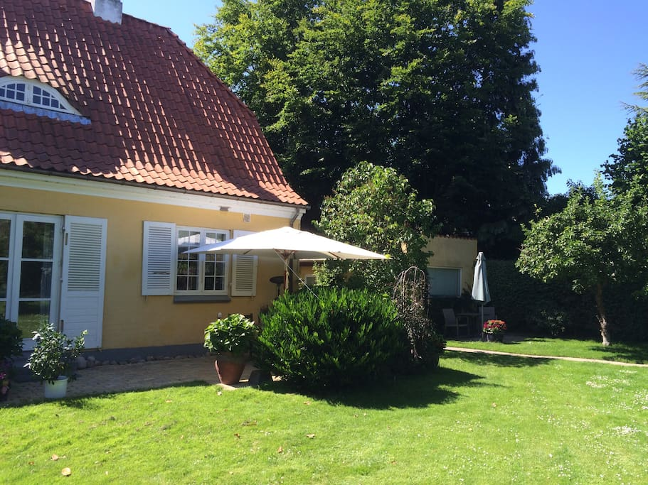 The villa with the cottage in the background.