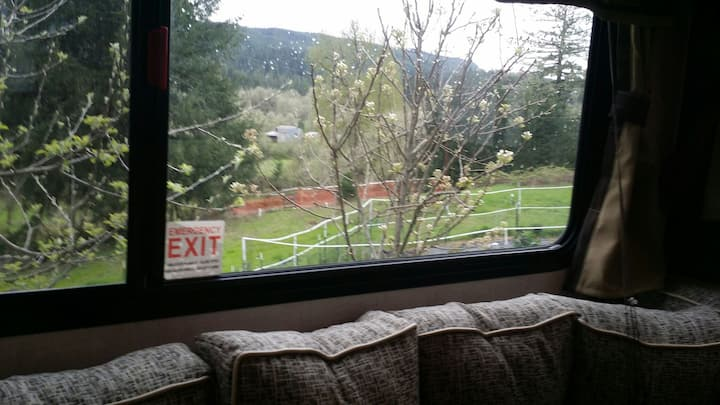 Comfy travel trailer with country views