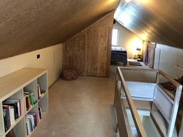 Private bedroom upstairs has it's own floor.