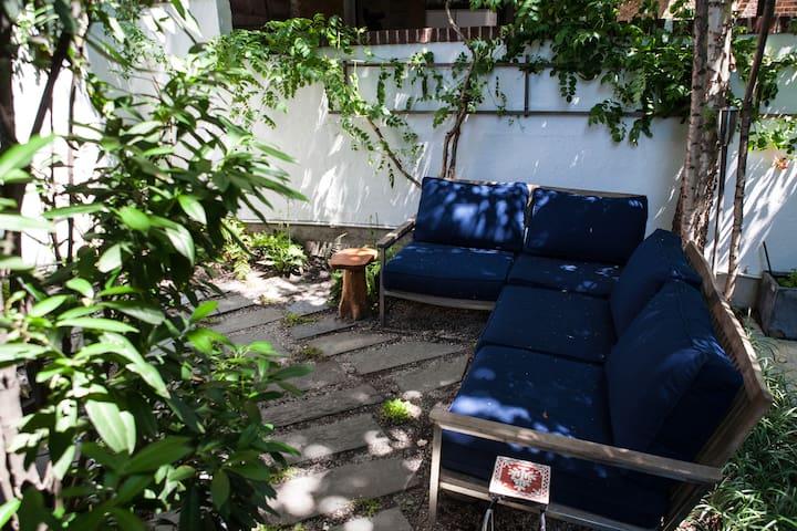 Private backyard lounge area.